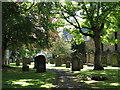 NY9864 : The graveyard of St Andrew's Church by Mike Quinn