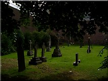 NN1073 : Graves in St Andrew's Church by Stephen Sweeney