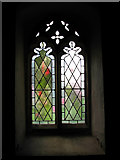 TG1022 : St Michael's church - south porch window by Evelyn Simak