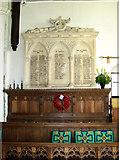 TG1022 : St Michael's church - war memorial by Evelyn Simak