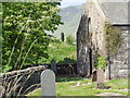 NO1070 : Spittal of Glenshee church and standing stone by Ewen Rennie
