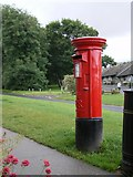 NU1834 : Postbox in the centre of Bamburgh by Richard Law
