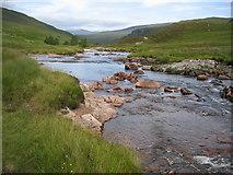 NN2868 : Abhain Rath winding peacefully down towards Staoineig by Pip Rolls