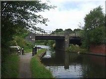 SK0305 : Wyrley & Essington Canal - Disused Railway Bridge by John M