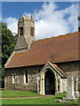 TG3109 : St Margaret's church - porch and tower by Evelyn Simak