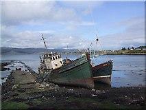 NM5643 : Rotting boats at Salen, Isle of Mull by Sarah Charlesworth