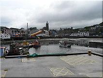 NR8668 : Tarbert: head of the harbour by Chris Downer