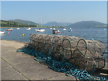 NS0767 : Port Bannatyne: lobsterpots on the pier by Chris Downer