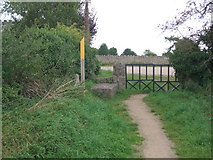 SK4023 : Stone stile and barrier by Bill Henderson