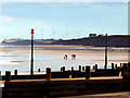 TA3526 : Walkers on the beach south of Withernsea by Andy Beecroft