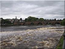 NX9676 : Old Bridge and Weir River Nith Dumfries by derek menzies