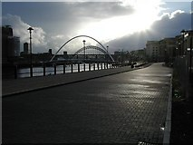 NZ2564 : Gateshead Millennium Bridge after the rain by Ed Jennings