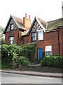 TG0433 : Terraced houses on Briston Road (B1354) by Evelyn Simak