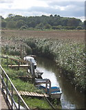 TG0444 : Creek with boats near Cley windmill by Andrew Hill