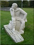 TQ1711 : Sculpture of St. Cuthman on St. Cuthman's Field opposite the church by pam fray