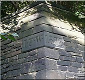 SE0724 : Date stone at corner of wall, Burnley Road, Halifax by Humphrey Bolton